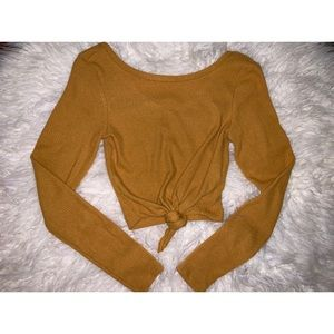Mustard knit cropped top.